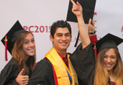 Photo of students in caps and gowns